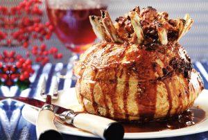 χριστουγεννιάτικο χοιρινό καρέ με σάλτσα μήλου γεμιστό στο φουρνο