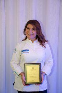"""Το τρίτο βραβείο """"Award of Excellence – In Recognition of Outstanding Dedication and Commitment To Promoting Greece's Culinary Tourism"""" επιδόθηκε στην Σεφ Αργυρώ Μπαρπαρίγου Global Ambassador of Greek Cuisine ή οποία δήλωσε συγκινημένη για τη διάκριση ενώ ευχαρίστησε το Λύκειον των Ελληνίδων για την τιμή, σημειώνοντας πως φέρνει μαζί της την αγάπη της Περιφέρειας Νοτίου Αιγαίου στους Έλληνες ομογενείς που τιμούν την παράδοση και τους θησαυρούς της Ελληνικής κουζίνας."""